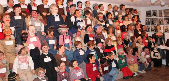 A wall of ventriloquist dummies at Vent Haven Museum