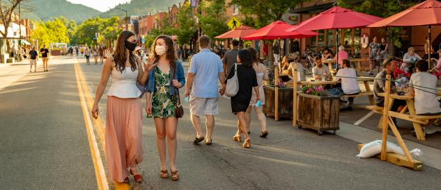 Women wearing masks talking and strolling in Downtown Dining Street Closure