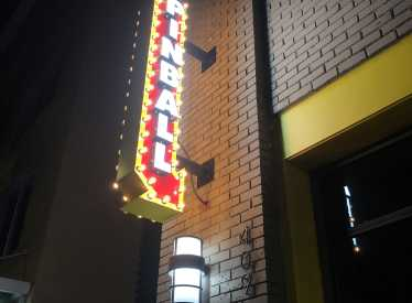 Pinball Sign At Night