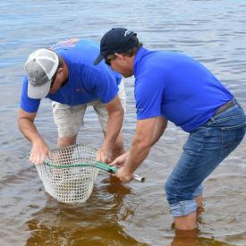 Brian Gorski, Executive Director of CCA Florida, and Sean Doherty of the Punta Gorda/Englewood Beach VCB Release a Tagged Redfish in Charlotte County Waters in Preparation for the CCA Florida STAR Tournament.