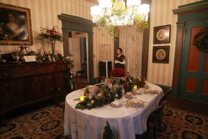 Festive decorated dining roomon Old Wilmington by Candlelight Tour