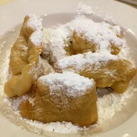 Pastrys topped with powdered sugar from Creole Kitchen