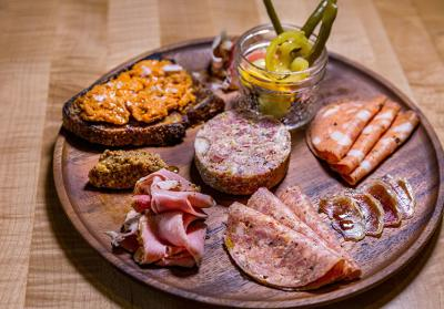 A charcuterie board of meats and pickles from Under the Oak Cafe in Smithfield