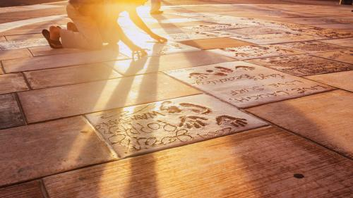 Put your hands in the imprints of famous surfers at the Surfers' Hall of Fame