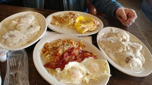 Four plates with eggs and hash browns at Hasty Tasty Pancake House in Dayton, OH