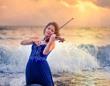 https://assets.simpleviewinc.com/simpleview/image/upload/crm/newportri/Irina-Muresanu-Violinist-Photo-Maaike-Bernstrom_B2BF266A-5056-B3A8-49C47965A82DA7D9_b2c547d1-5056-b3a8-49e6ee7acb602d25.jpg