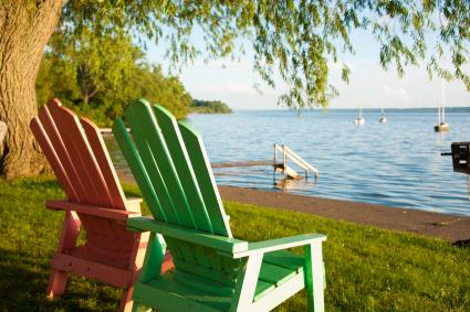 Two empty lawn chairs sit overlooking Seneca Lake