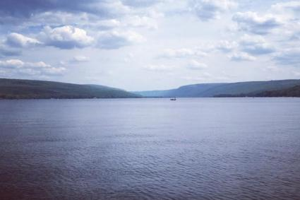 A view of Honeoye Lake during a blue skied day