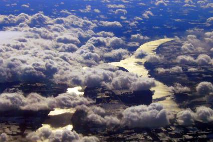 An aerial view of Keuka lake with clouds surrounding it