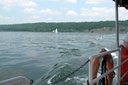 A sailboat embarks for a day of adventuring on Cayuga Lake