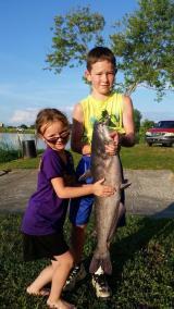 Kids holding a fish at Kopps Lake