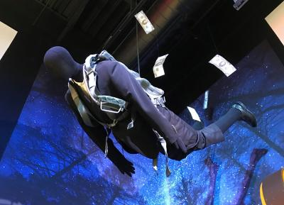 Dummy parachuting with money flying