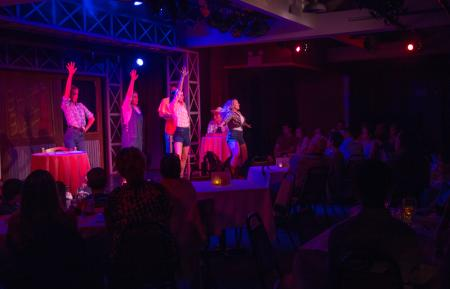 On-stage performance at the Pines Dinner Theatre