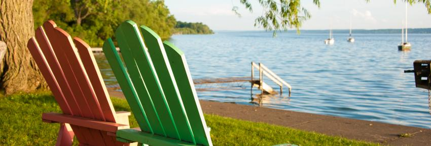 Two lawn chairs overlook Seneca Lake