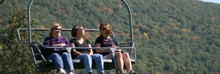 finger-lakes-bristol-mountain-canandaigua-fall-sky-ride-three-women-in-chair