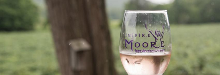A glass sits half full at Inspire Moore Winery in Naples