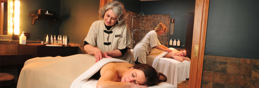 A woman receives a massage inside of Isabella Spa at Belhurst Castle