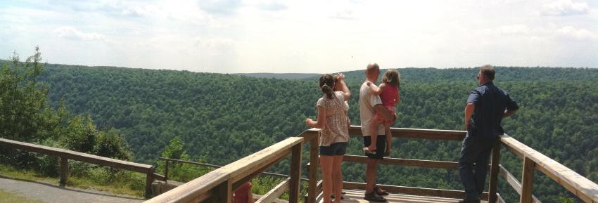 A family enjoys the view at Gannett Hill Parks overlook