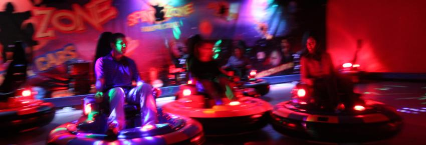A group of people enjoy a round of bumper cars inside of the Roseland Family Fun Center