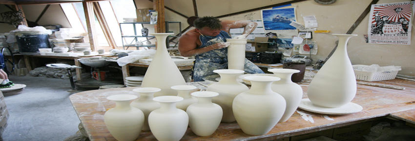 Freshly made clay pottery sits inside of the Wizard of Clay