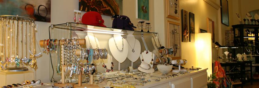 Handcrafted jewlery sits for sale inside of Adorn Jewelry