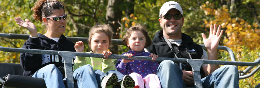 A family waves while on a chairlift skyride at Bristol Mountain