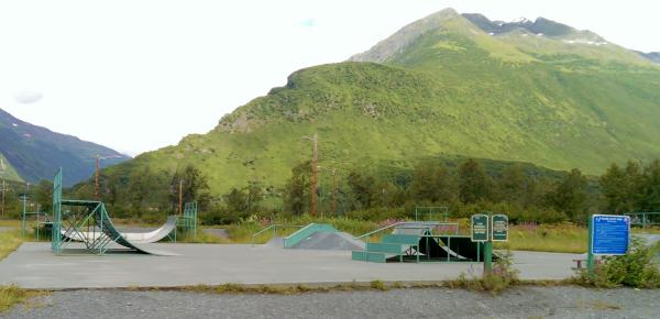 a skate park with mountains in the background