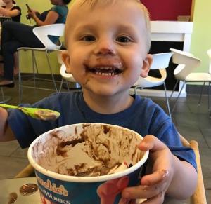 Little boy enjoying Menchie's FroYo