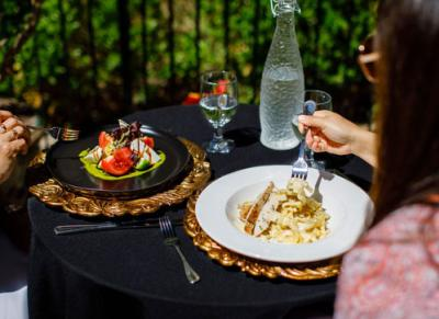 Couple dining outdoors at the Venetian Terrace in Irving