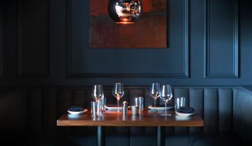 Place Settings And Wood Paneling In Kaiser's Chophouse Booth