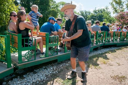 Woode Wood performs for families riding the Zilker Zephyr miniature train in Zilker Park