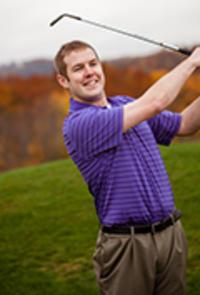 David Lee poses swinging a golf club