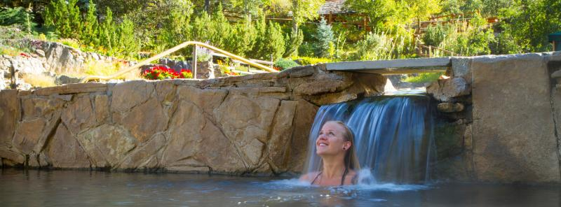 Soak under the waterfalls at Strawberry Park Hot Springs