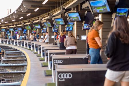 People in bays at topgolf during Thanks FORE Giving Topgolf Tournament hosted by Visit Austin Foundation