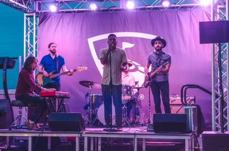 Tomar and the FCs band plays on stage at Thanks FORE Giving Topgolf Tournament hosted by the Visit Austin Foundation