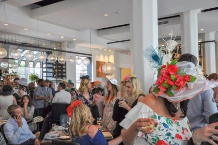 Photo of women in hats at a derby day party at coppins at hotel covington