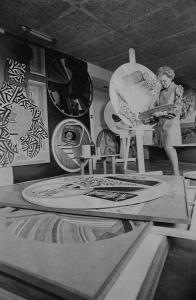 Black and white photo of Eve Drewelowe working on her artwork
