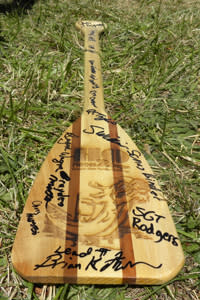 The team of Warriors signed their awards paddle.