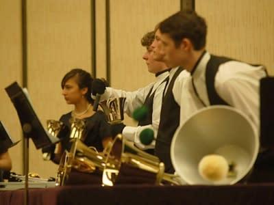 3 Handbell Musicians performing