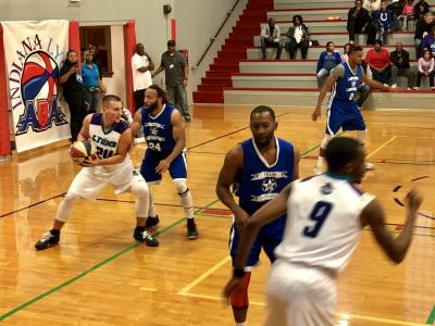 Indiana Lyons forward Preston Case (No. 24) prepares to pass the ball during the team's inaugural ABA game.