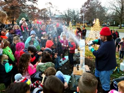 Ice sculptor demonstrating for a group of children at Worthington's annual Holiday Open House & Tree Lighting