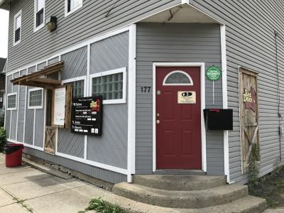 Storefront of Red Door BBQ soul food restaurant