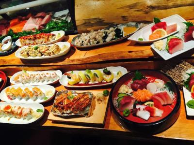 Spread of sushi dishes on long table