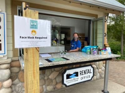 The new socially distanced sign-in being manned by Morgan Taylor at Crystal River Outfitters
