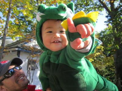 Little boy in dinosaur costume enjoys Zoo Boo at the Seneca Park Zoo