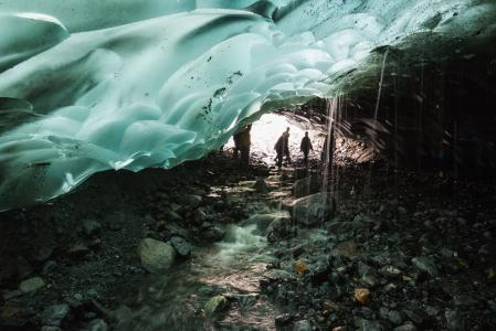 Aaron Theisen Ice Caves melting from roof of cave onto stone floor