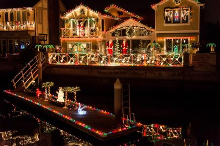 Homes and boats in Huntington Harbor are adorned with lights and decorations to celebrate the holidays! (Photo courtesy of Cruise of Lights / Facebook)