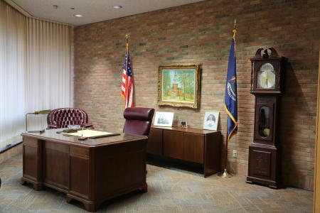 President Gerald Ford's desk, clock, flags, and other paraphernalia in his office at the Gerald Ford Library