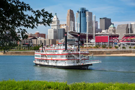 photo of a paddlewheel riverboat from bb riverboats in newport kentucky with the cincinnati oh skyline in the background