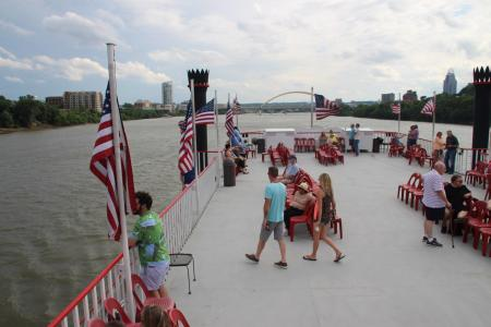 View of people looking over the top deck of BB Riverboats cruise on the ohio river